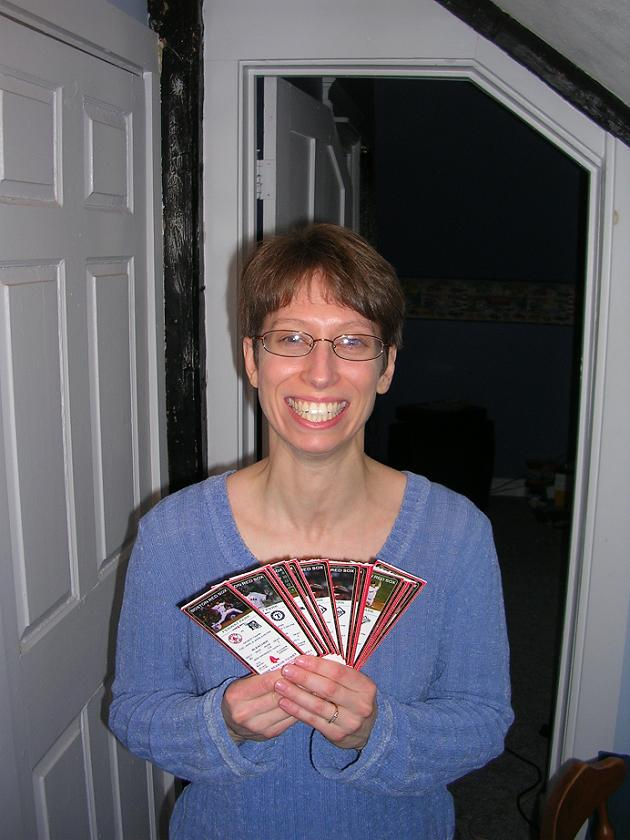 susan with glasses and tickets